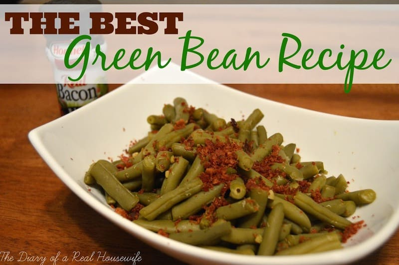 Green Beans topped with bacon bits in white platter