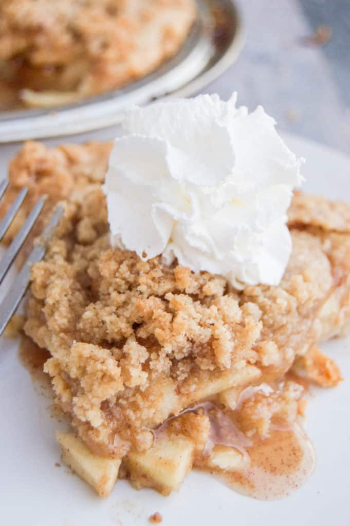 Dutch Apple Pie on a white plate with a fork